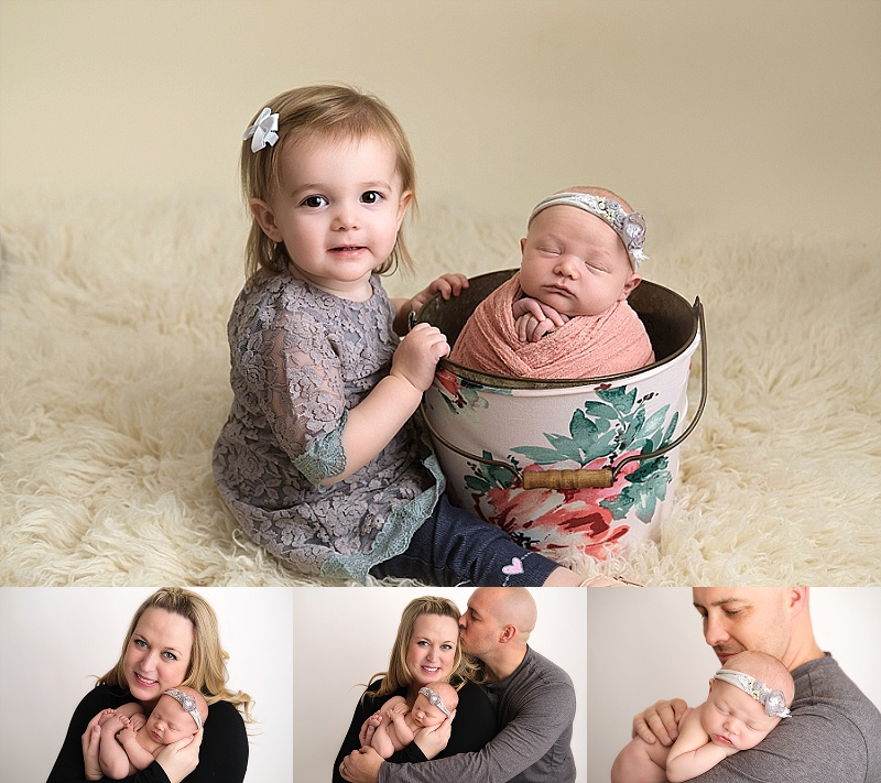 newborn girl with big sister and family photos