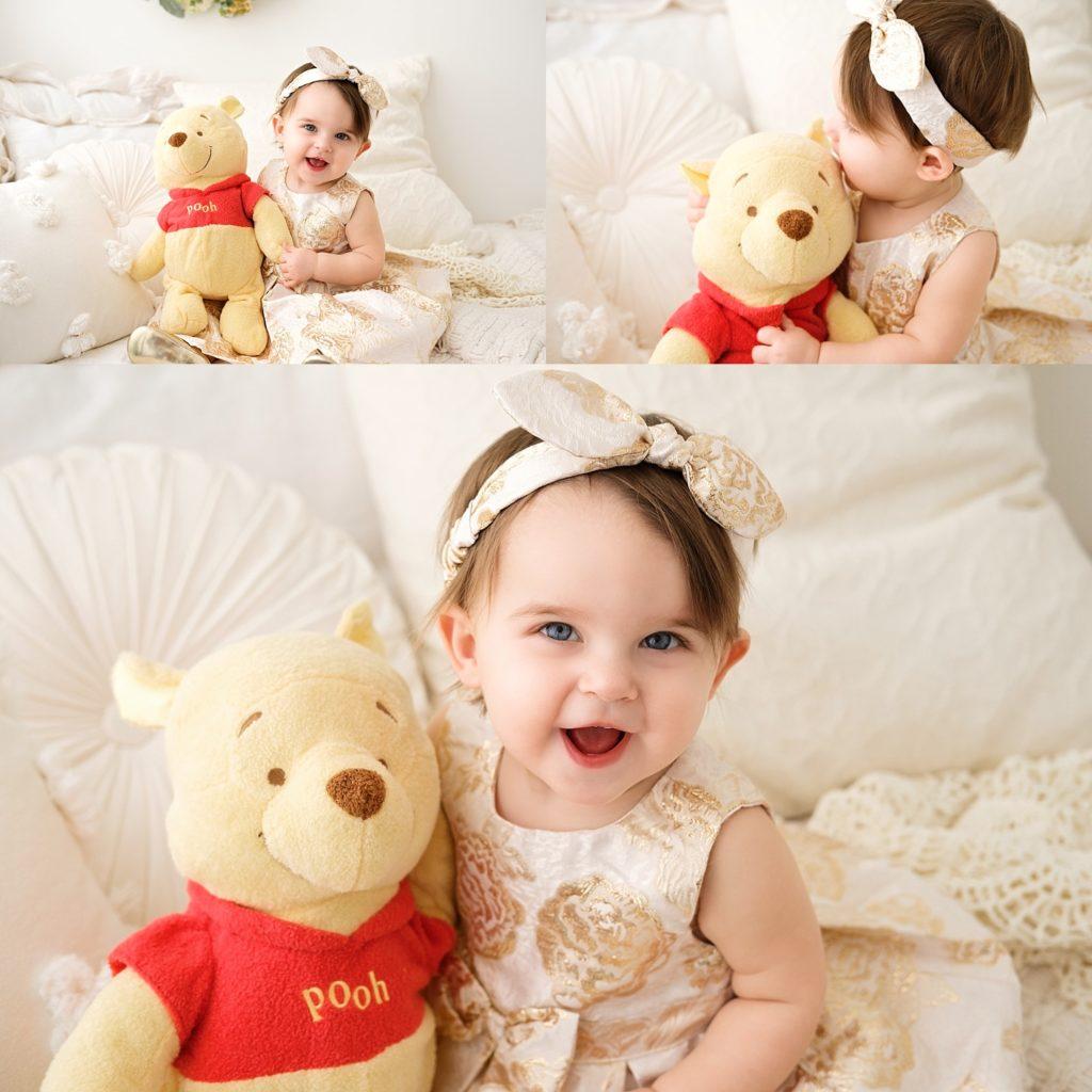 birthday girl with pooh bear stuffed animal