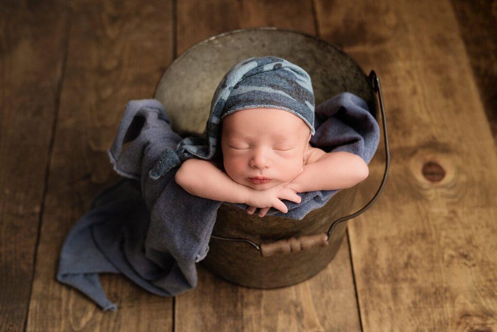 bucket pose with newborn boy