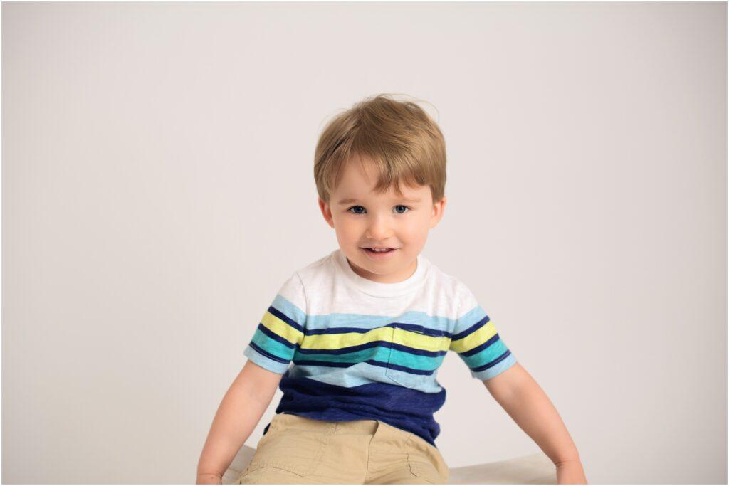 2 year old boy in striped shirt