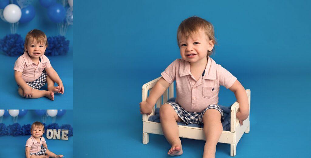 boy on blue background one year photos