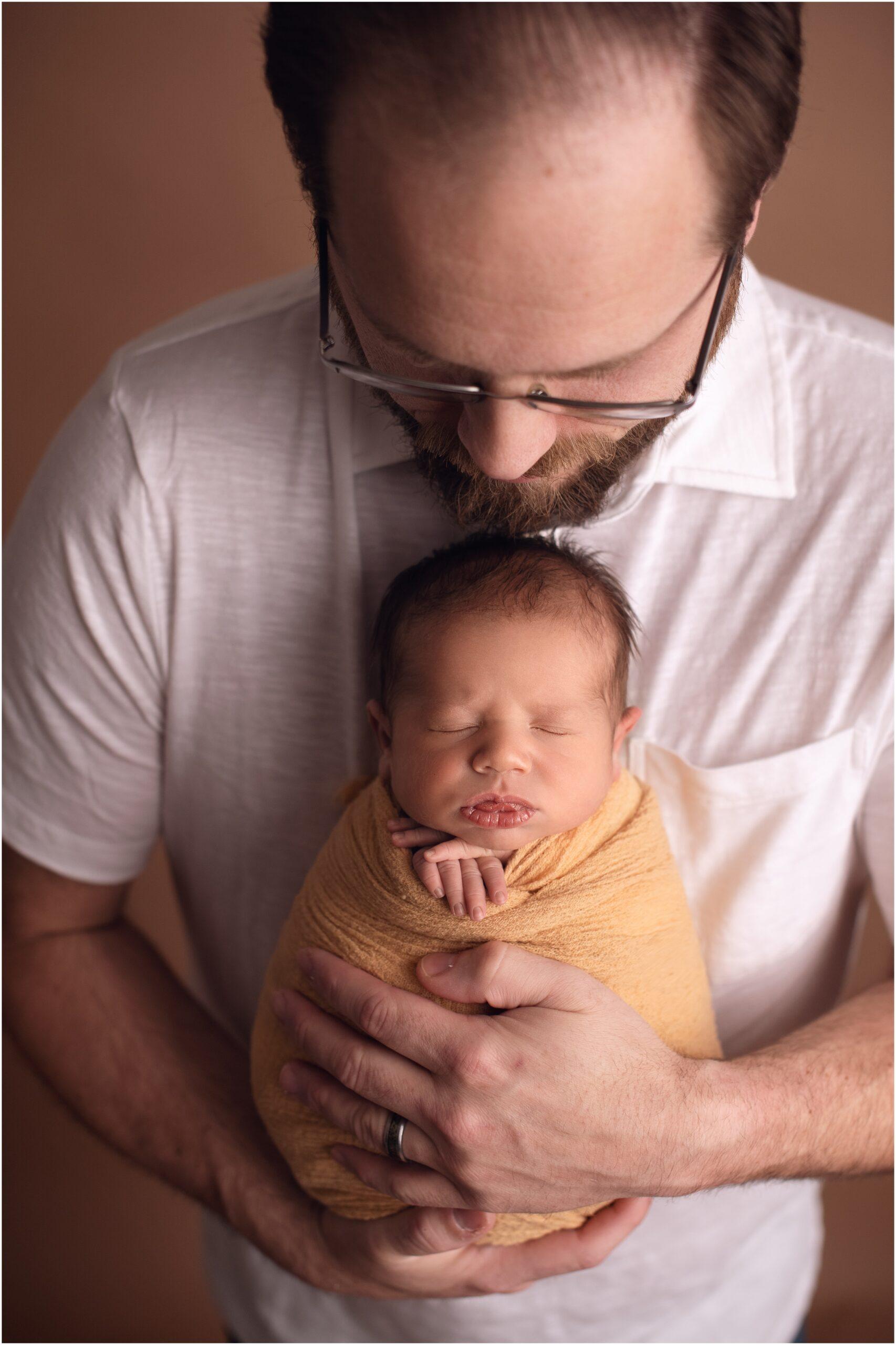 newborn boy with dad
