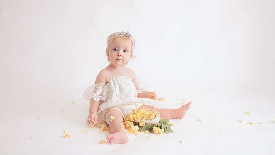 first birthday eating cake milestones photography Katie Anton Photography