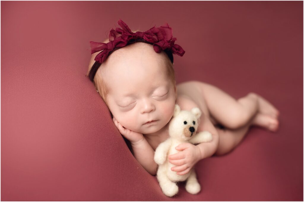 newborn girl with teddy bear