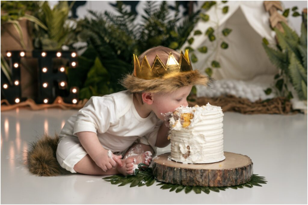 boy face first in cake