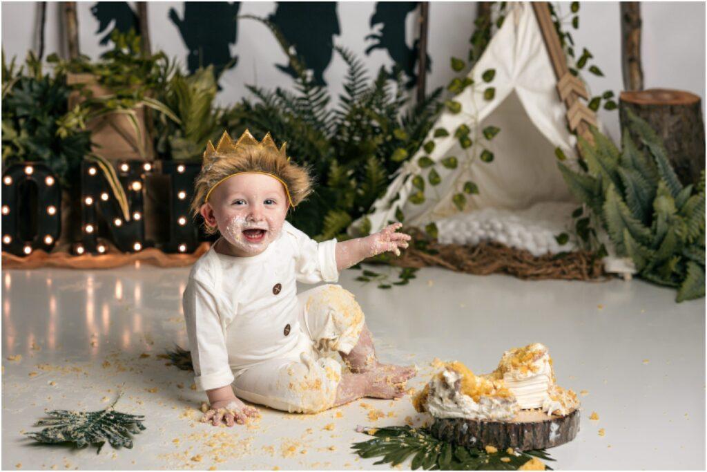 boy smiling during wild things cake smash