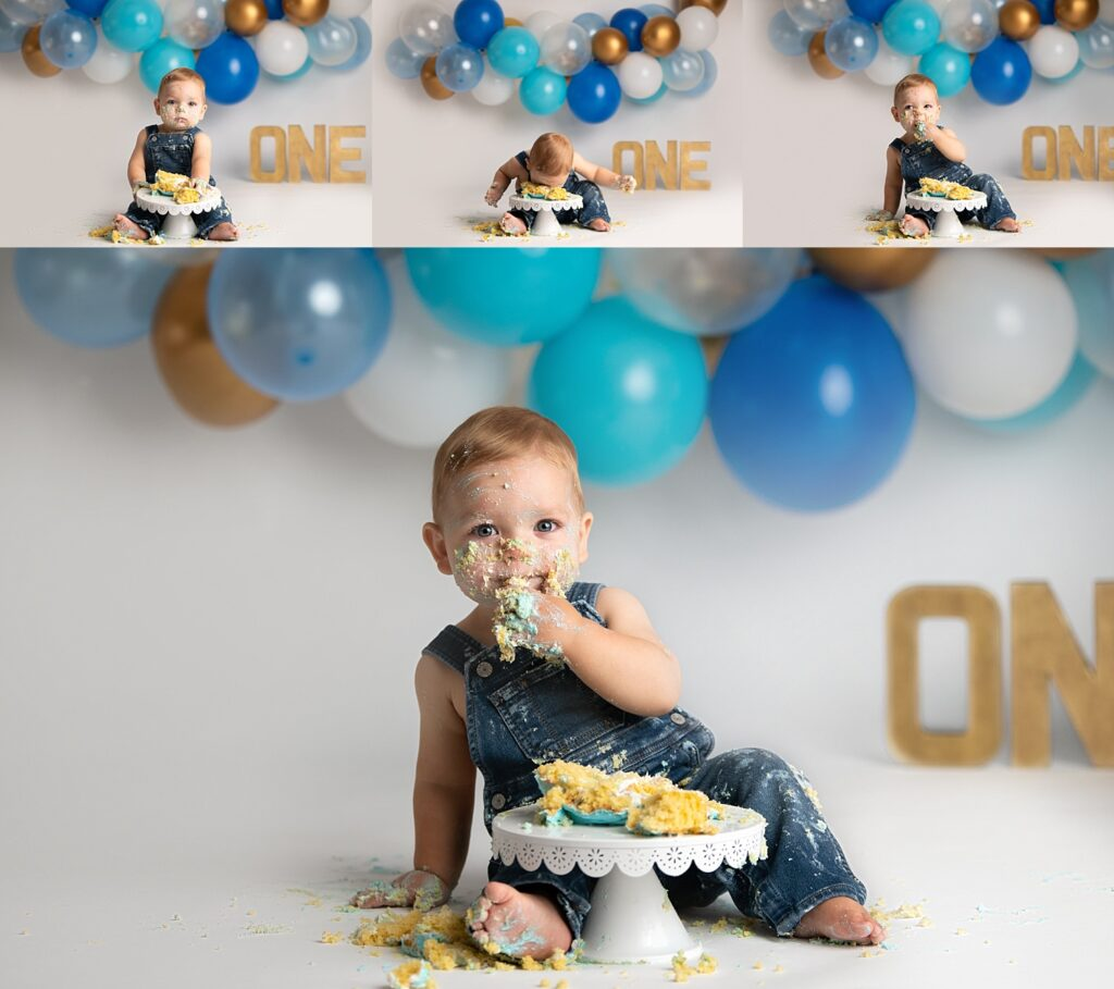boy cake smash with blue balloons