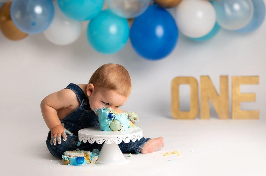 boy face first in birthday cake