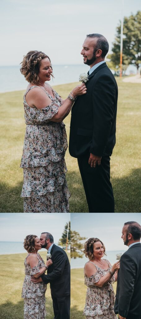 groom with mom putting on boutonniere