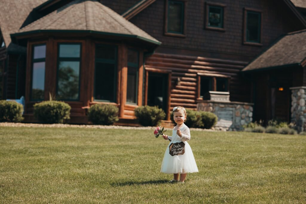 port Sanilac wedding flower girl holding sign that says daddy here comes mommy