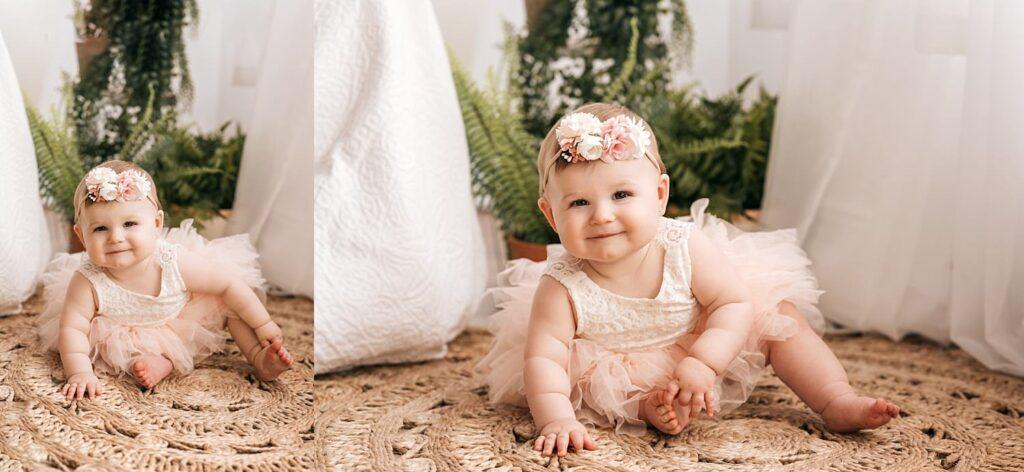 little girl sitting on rug