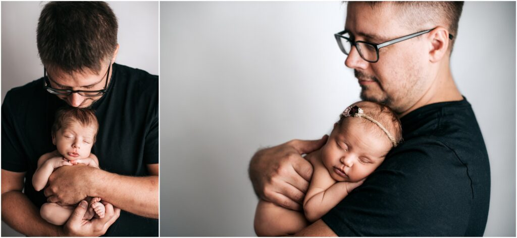 dad poses with newborn twins